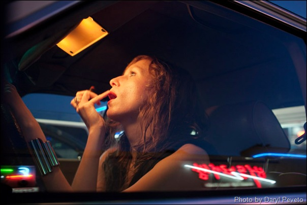 Los Angeles–based singer-songwriter Cameron Mesirow applies lipstick while sitting inside of her 1985 Mercedes in the Koreatown section of Los Angeles, California, June 16, 2009. Mesirow created the musical project Glasser and has just released her first demo available only on vinal  or through iTunes.